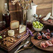 Dark natural double sided wood cutting board perfect for rustic serving of cheese ham meat fish more