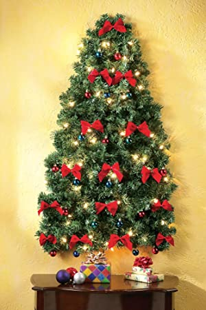 realistic evergreen branches are adorned with white led christmas lights red and blue ornaments and red velvet bows