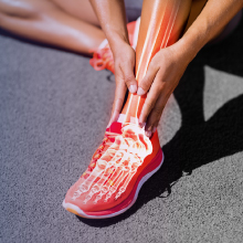Runner massaging ankle. Zhou Black Seed Oil works to aid in joint comfort and mobility.