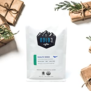 OLD3 Coffee as a gift surrounded by gold gifts on a white background