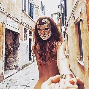 Magic of Venezia mask on girl in Venice