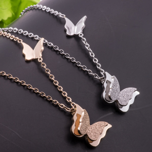 8807cf757 Amazon.com: WDSHOW Rose Gold Plated Stainless Steel Butterfly ...