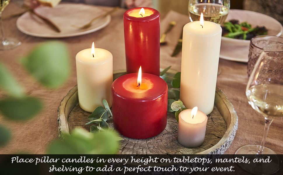 different sizes pillar candles red