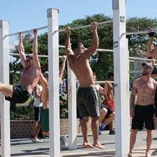Guys doing healthy exercises at Bondi outdoor gym