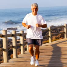 Healthy Manrunning pain free on beach boardwalk