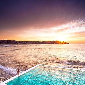 Vibrant early morning sun rising on Bondi Beach