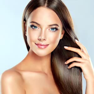 Beatiful lady with strong hair, healthy nails and clear young looking skin