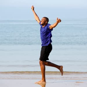 Energetic man exercising on beach