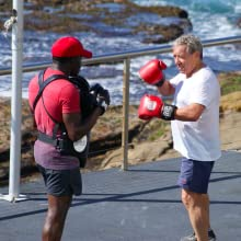 Two healthy men doing boxing training