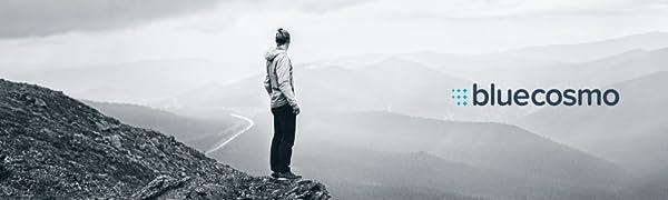 BlueCosmo logo with man standing next to mountains
