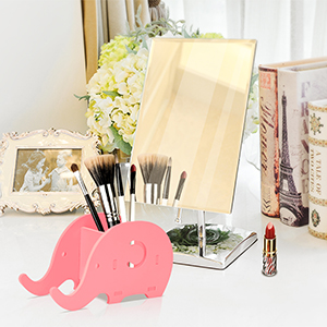 Pink elephant holder in the room