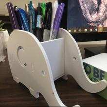 Elephant pen holder on the desk