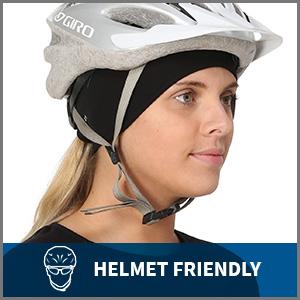 Woman wears black ponytail headband as ear protection under bike helmet. Captioned helmet friendly.