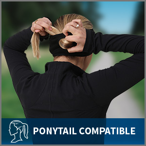 Woman pulls her hair through the ponytail opening of a black headband. caption: ponytail compatible