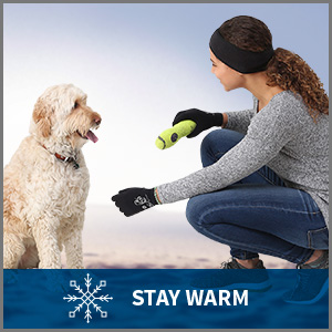 Woman in a cold weather running headband plays with her dog. Caption: stay warm