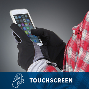 Woman uses black and grey touchscreen gloves to look at her phone.