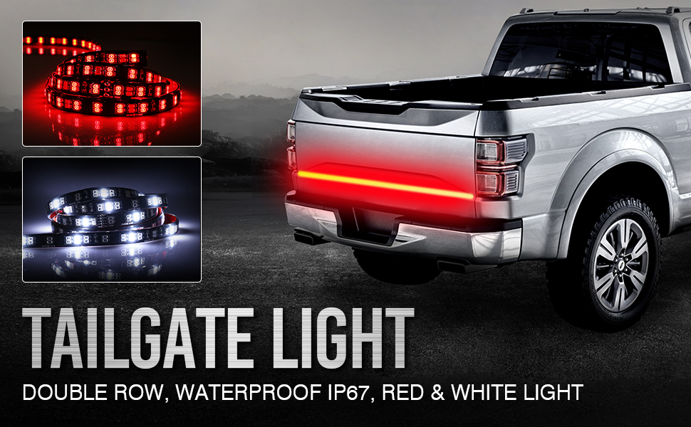 there are a tailgate light bars in white light and red light withe a pickup nearby
