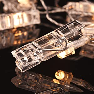 592bb654d5 16 clear photo-clips. Each clip contains a LED that emits warm white light.
