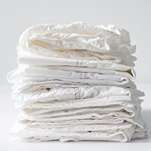 alterra pure recommends washing organic percale sheets in warm water and ironing
