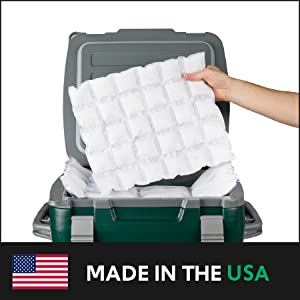 Person holding a sheet of ThermaFreeze above a travel cooler; text: made in the USA