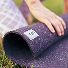 Girl's hands on rolled up yoga mat