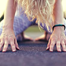 Girl's hands on yoga mat showing grijp