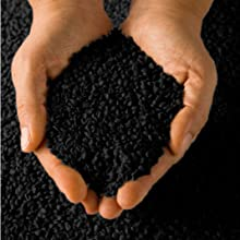 Hands holding crumb rubber