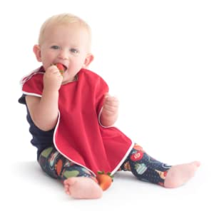 cute baby feeding on fruit wearing red large waterproof toddler bib snap buttons