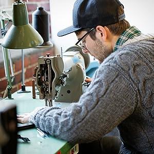 Man sewing outdoor gear