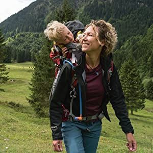 Mom carrying child with kid carrier backpack by Deuter