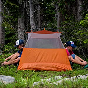 Two People Camping in a copper spur tent in the woods