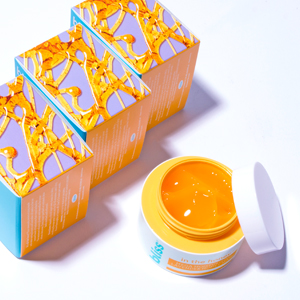 3 packaging boxes and one open jar of honey mask