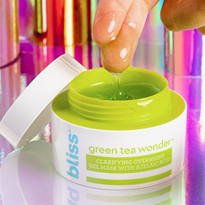Open jar with fingers showing product gel-like consistency