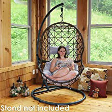 model shown sitting on egg chair inside