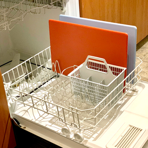 A red and blue HDPP plastic cutting board is dishwasher safe up to 250 degrees.