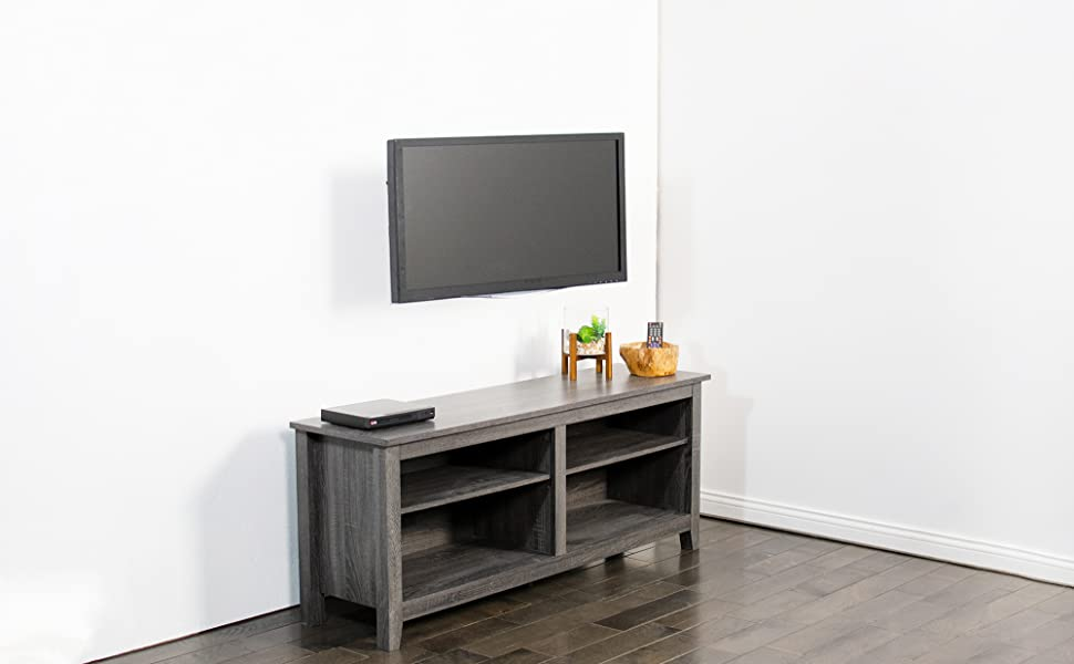 tv wall mount set up above entertainment stand