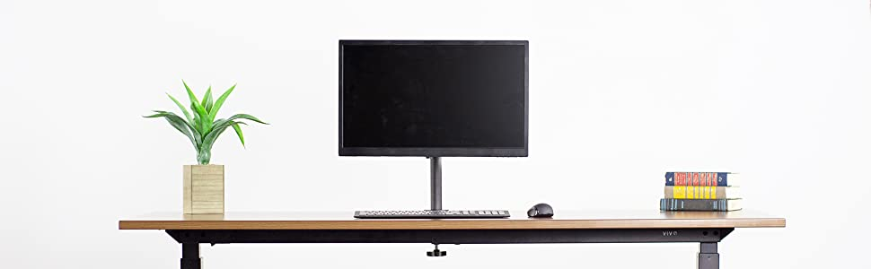 longer banner image of single monitor mount desk scene