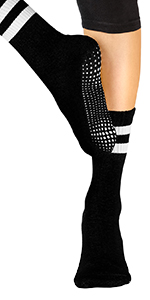Model wearing black spandex tights and crew style yoga sock showing custom grip