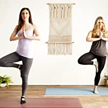 Two women wearing yoga socks doing a standingyoga pose