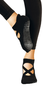 Model wearing black spandex tights and point style yoga sock showing custom grip