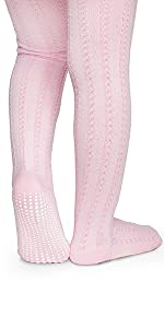 model in cable stitch pattern pink tights with max traction non skid anti slip soles