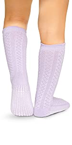 model in cable stitch pattern violet sock with max traction non skid anti slip soles