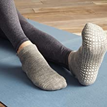 Close up of grey covered barre sock on model showing white maximum sticky grip