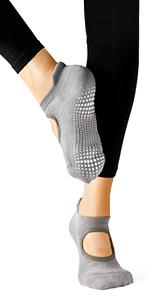 Model wearing black spandex tights in ballet style yoga sock showing custom grip
