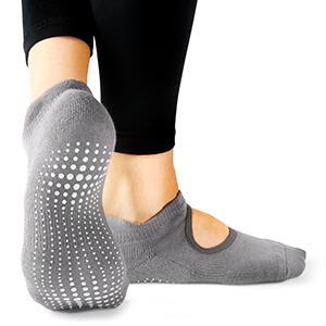 Grey ballet style sock on foot model displaying custom white grip pattern