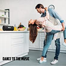 dance to the beat kitchen music cooking cleaning passing time loud sound volume sweeping dancing