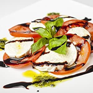 giuseppe giusti balsamic vinegar of modena on fresh salad food paring