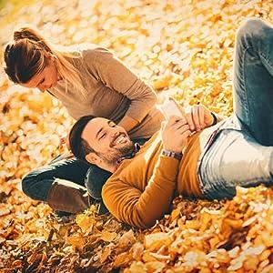women men laying on the grass relaxing