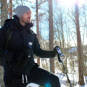 Picture of Chris holding a Wild Wolf Outfitters water bottle carrier in snowy landscape in Sweden