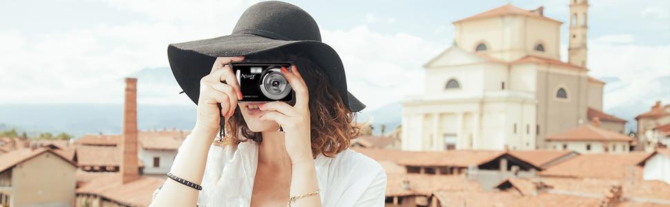 Girl taking photo with acuvar 14 megapixel camera